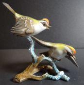 Vogelpaar auf Ast, bemalt, H-14 cm, B-16 cm- - -22.61 % buyer's premium on the hammer priceVAT