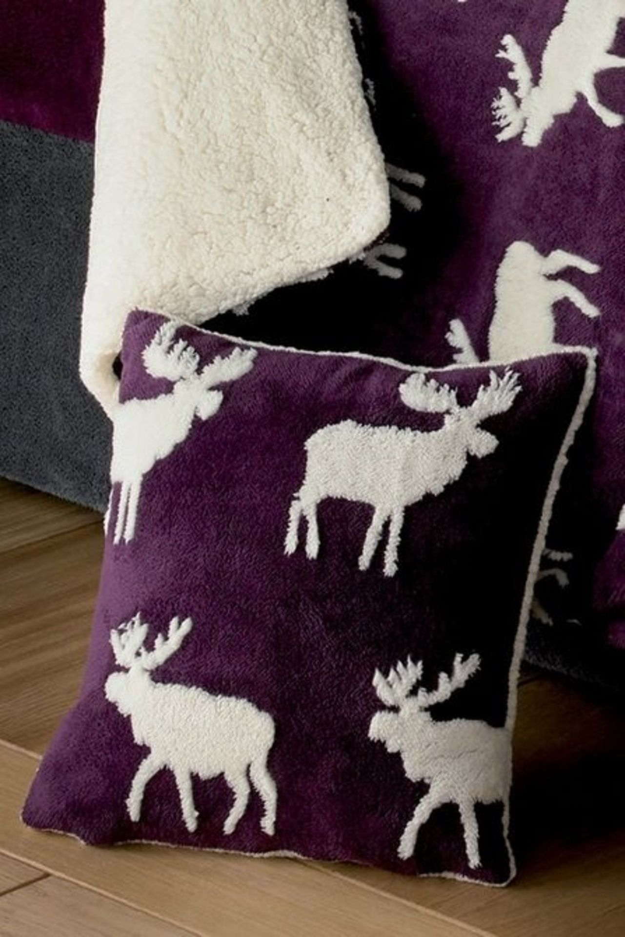 Lot 50 - 1 BAGGED WARM AND COSY TEDDY 3D STAG CUSHION COVER IN PLUM (PUBLIC VIEWING AVAILABLE)
