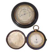 ϒ A Victorian gilt brass cased aneroid pocket barometer