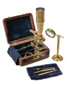 A Cary/Gould-type lacquered brass portable compound microscope