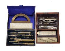 ϒ A Victorian mahogany cased set of drawing instruments