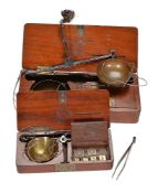 Two French mahogany cased sets of portable diamond scales