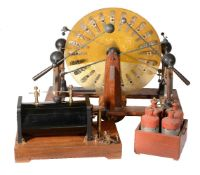 A mahogany brass and glass Wimshurst electrostatic generating machine