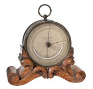 A brass aneroid desk barometer with thermometer
