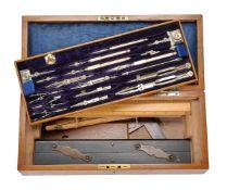 ϒ An Edwardian/George V oak magazine of draughtsman's drawing instruments