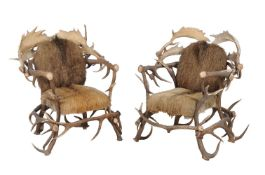 A pair of antler constructed throne chairs