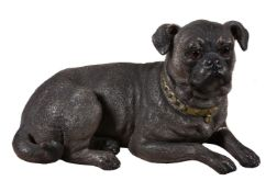 An Austrian painted terracotta model of a recumbent pug