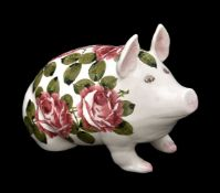 A Wemyss (Plicta) model of a pig painted by Joseph Nekola with roses