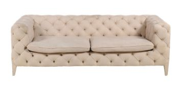 A button upholstered sofa