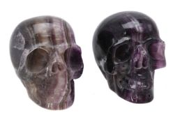 Two carved fluorspar (fluorite) models of human skulls