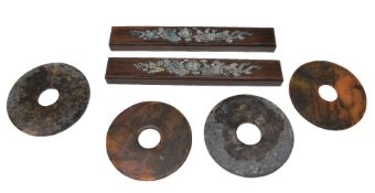 ϒ A pair of Chinese hardwood scrollweights and four jade bi
