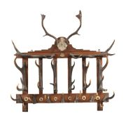 An Edwardian oak and antler mounted wall hanging hat and coat rack