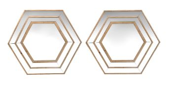 A pair of softwood hexagonal marginal mirrors