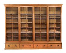 A large pitch pine and glazed bookcase in Victorian style