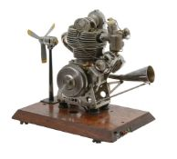 An exhibition standard ½ size working model of a 44cc OHC Internal combustion motor cycle engine