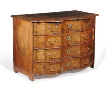 A Continental walnut serpentine fronted commode