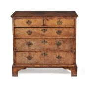 A William III walnut and feather banded chest of drawers