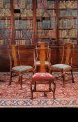 A set of four George I walnut chairs