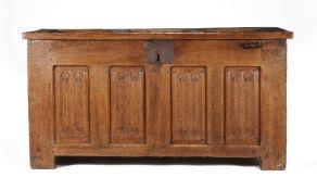A Tudor panelled oak chest