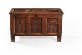 A Charles II panelled oak chest