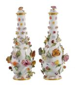 A pair of Meissen slender ovoid flower-encrusted vases and covers