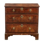 A George II walnut and featherbanded chest of drawers