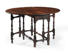 A 'red walnut' and oak gateleg dining table