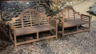 A pair of teak garden benches, of recent manufacture, in the manner of designs by Lutyens, the