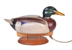 Alan Emmett (1938-2008); a modern carved and painted wood model of a duck decoy, the keel with