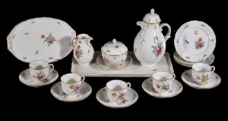 A modern Nymphenburg part coffee service, painted with deutsche Blumen beneath ozier-moulded