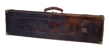 A leather and brass-bound gun case, early 20th century, for a single gun, 9cm x 83cm x 22.5cm