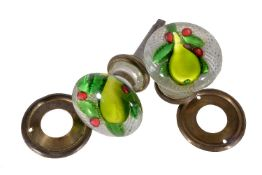 A pair of St. Louis glass door knobs with fruit inclusions, mid 19th century, in the manner of St.