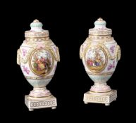 A pair of Dresden porcelain urns and covers, late 19th century, moulded with leaf and berry swags