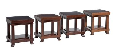 After Frank Lloyd Wright, four dark wood occasional tables by Cassina, stamped marks, circa 1989,