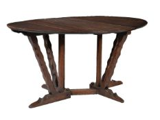 An Arts and Crafts oak gateleg table, circa 1910, attributed to Arthur Romney Green (1872-1945),