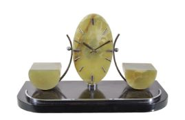 An Art Deco green and black onyx mantel clock, the eight day timepiece movement with six rubies,