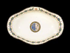 A Turner creamware crested and armorial quatrefoil bowl, late 18th century, decorated with a