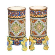 A pair of Fischer Budapest pottery cylindrical vases, circa 1890, printed and painted in the Persian