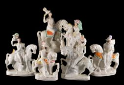Six Staffordshire pottery sparsely coloured and gilt equestrian models of royal or military figures,