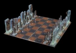 Mabel Waisman (Argentina, 1949-2005), an art glass chess board and pieces, fused slab glass, gold