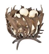 A fallow deer antler formed jardiniere stand, circa 1900, of openwork construction and oval section,