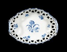 A Worcester blue and white pierced two-handled basket, circa 1780 printed with the 'Gilliflower