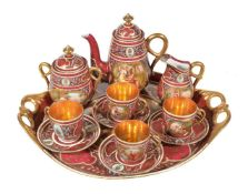 A Vienna-style claret and gilt ground part coffee service, circa 1900, decorated with titled
