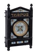 An Aesthetic Movement ebonised mantel clock, late 19th century, in the manner of Lewis Foreman