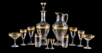 A Moser glass part table service, circa 1962, decorated with an acid-etched and gilt stylised