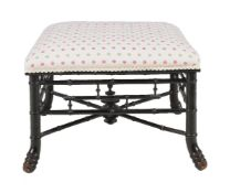 An Aesthetic Movement ebonised and upholstered foot stool, late 19th century, the frame to