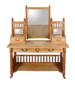 An Aesthetic Movement ash dressing table by Heal & Son, circa 1890, with galleried and mirror backed