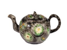 A Staffordshire globular creamware teapot and cover, mid 18th century, with crabstock handle and