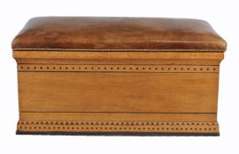 An Aesthetic Movement ash and leather upholstered Ottoman, circa 1890, 53cm high, 105cm wide, 61cm