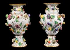 A pair of Meissen (outside decorated) flower and fruit encrusted ozier-moulded baluster vases,